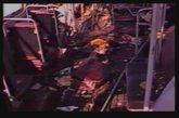 1997年,被东突恐怖分子炸毁的公共汽车残骸。(图为视频截图)