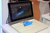 Keeley Lake:英特尔在Computex2011上展示了一款融合了平板电脑和笔记本电脑两种形态的产品,更确切的说,这是一种解决方案的展示。
