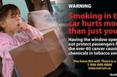 坐在车中后座上的小女孩在烟雾缭绕中咳嗽不止。香烟的烟雾中含有60种致癌化学物质。在轿车中吸烟可以严重影响车内的其他乘客,打开车窗起到的作用非常有限。(资料图)