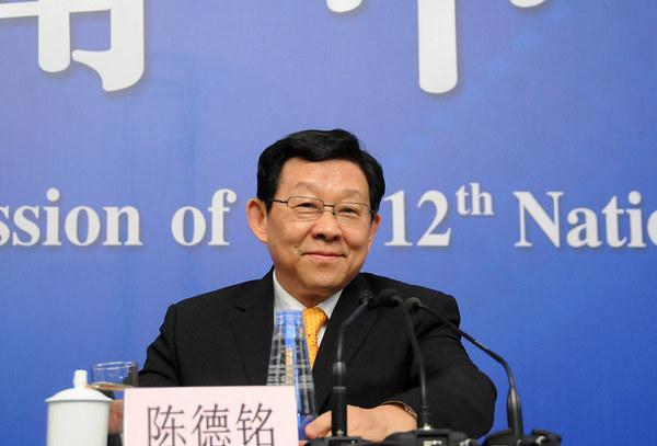 图为商务部部长陈德铭回答记者提问.新华网/中国政府网翟子贺摄