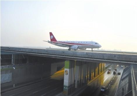 双流机场二跑道启用 首架飞机飞往九寨沟